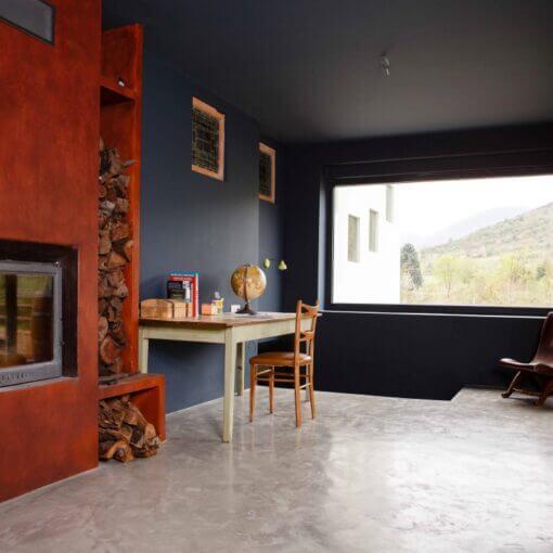 Salón con suelo de microcemento - Decoraciones Montoya